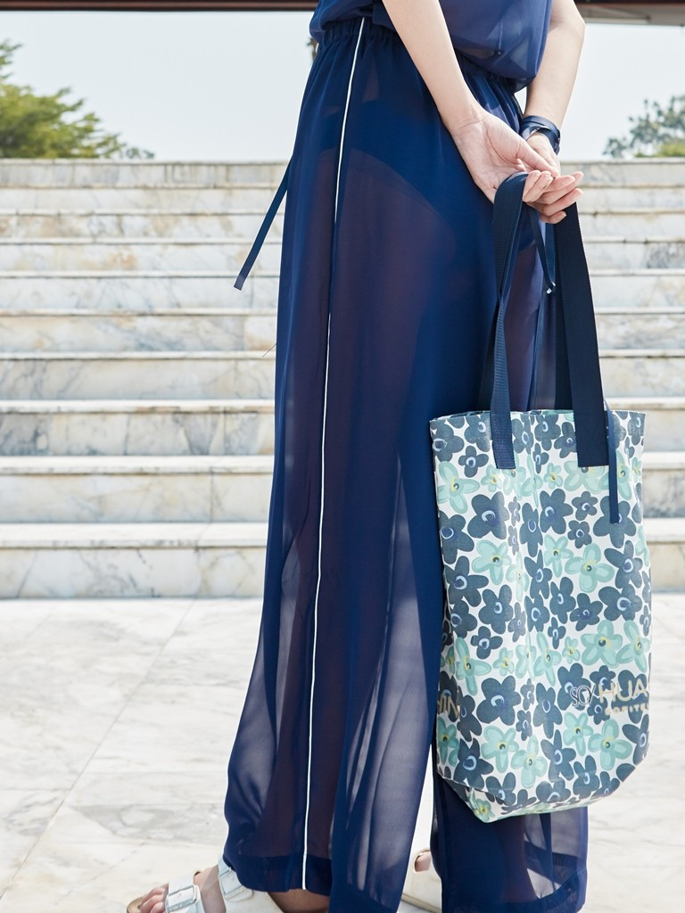 https://www.so-sofitel-huahin.com/wp-content/uploads/sites/73/2018/02/Blue-Pants-with-Floral-Tote-Bag.jpg